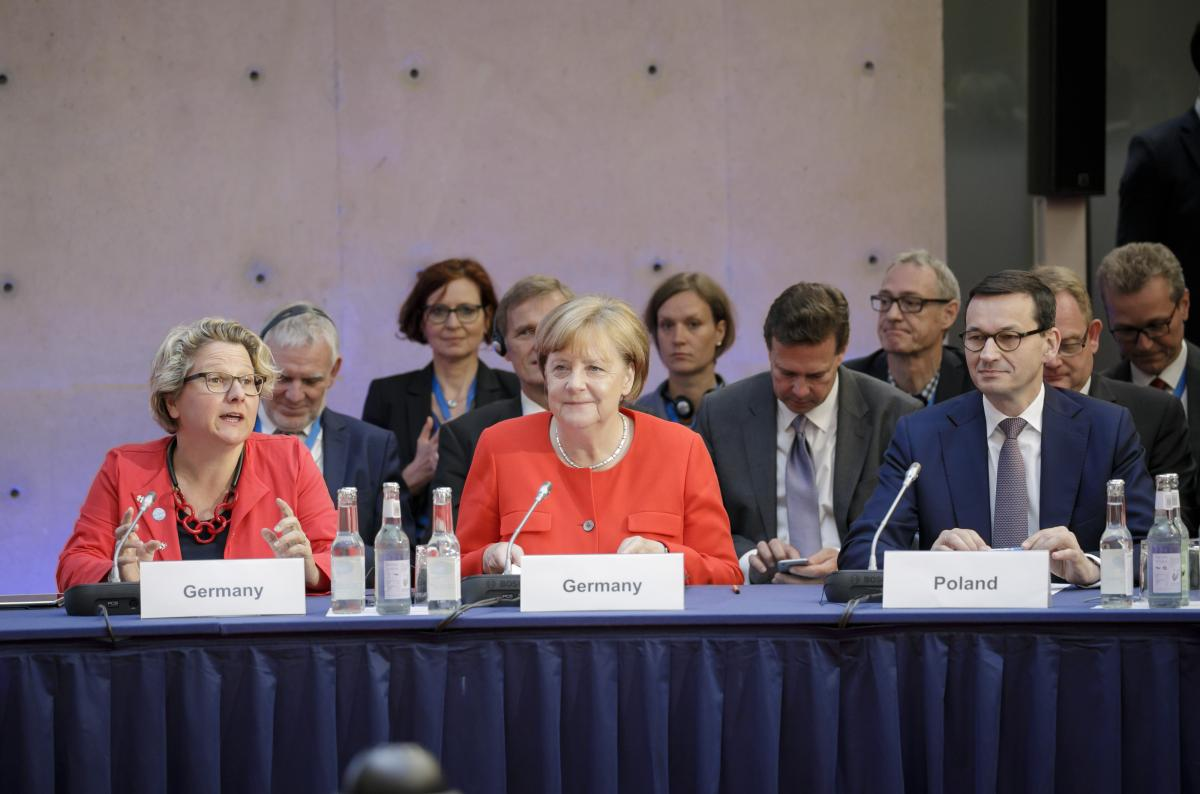 German environment minister Svenja Schulze, chancellor Angela Merkel and Polish Prime Minister Mateusz Morawiecki at the 9th Petersberg Climate Dialogue in Berlin. Source - BMU/Thomas Koehler 2018.