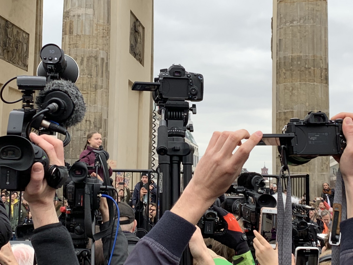 Swedish climate activist Greta Thunberg was met with a swarm of cameras and thousands of supporters when she spoke at Brandenburg Gate in Berlin on March 29, 2019. Photo: Rachel Waldholz