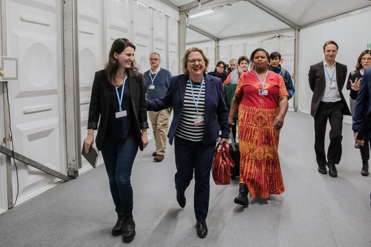 Germany's environment minister Svenja Schulze on her way to the Talanoa Dialogue: NGO's later pointed out that there is a gap between the picture Germany portrays at the COP and the lack of climate action at home. Photo: Sascha Hilgers, BMU.