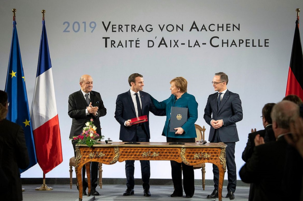 Photo shows French President Emmanuel Macron and German Chancellor Angela Merkel signing the new friendship treaty in the German city of Aachen. Photo: Bundesregierung/Bergmann 2019.