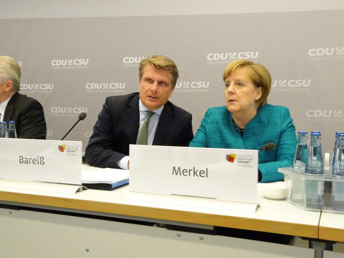 Thomas Bareiß and Angela Merkel at the 8th Energy Policy Dialogue by CDU/CSU Parliamentary Group in the German Bundestag. Source - CLEW 2017.