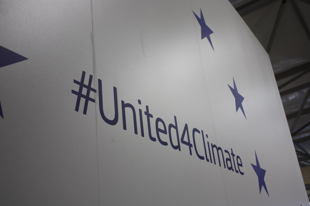 "A sign reading ""#United4Climate"". Source - CLEW 2017."