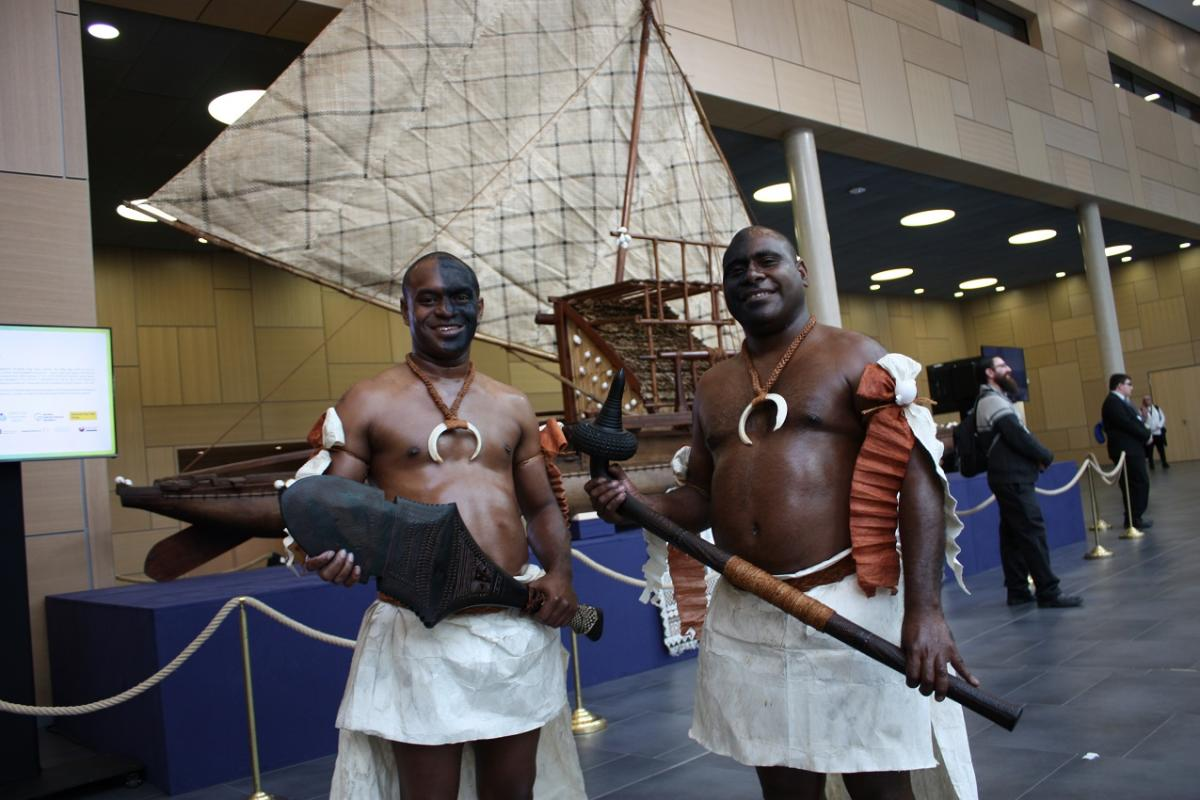 Fijian islanders in front of canoe at COP23 in Bonn, Germany. Source - CLEW 2017.