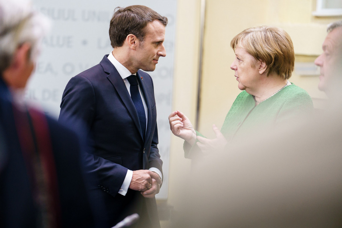 Photo shows French President Emmanuel Macron and German Chancellor Angela Merkel at the EU leaders summit in Sibiu, Romania. Photo: Bundesregierung/Denzel 2019.