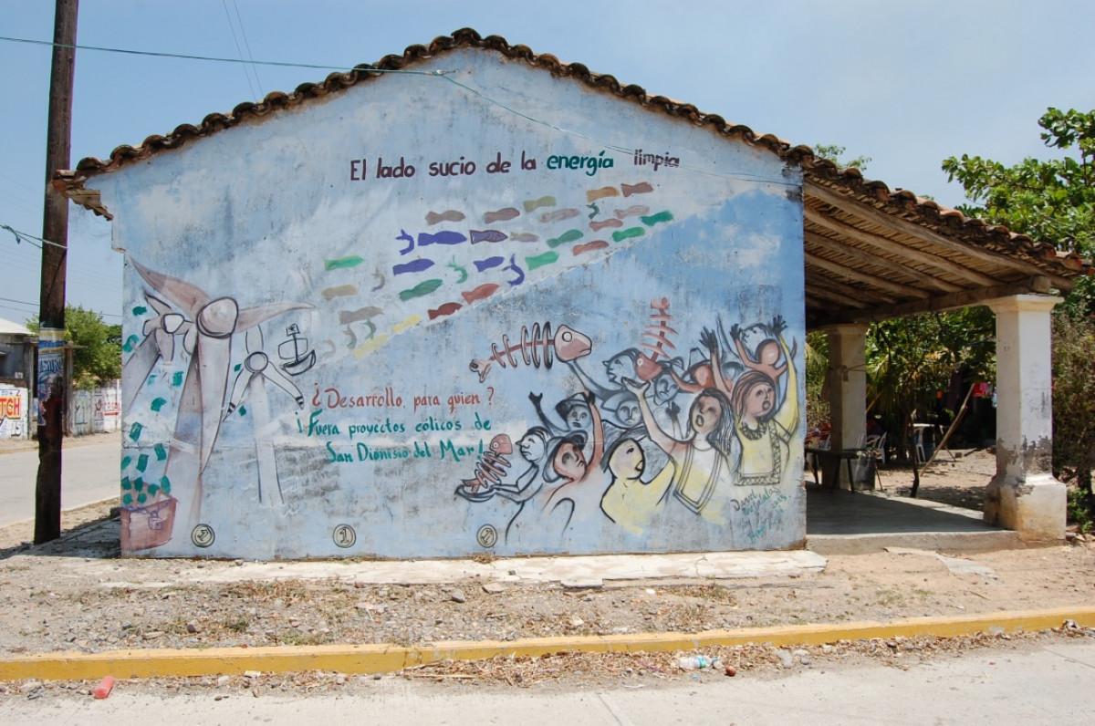 """The dirty side of clean energy"" found on a wall in San Dionisio del Mar, Oaxaca, in the South of Mexico. Photo: Juan Mayorga"