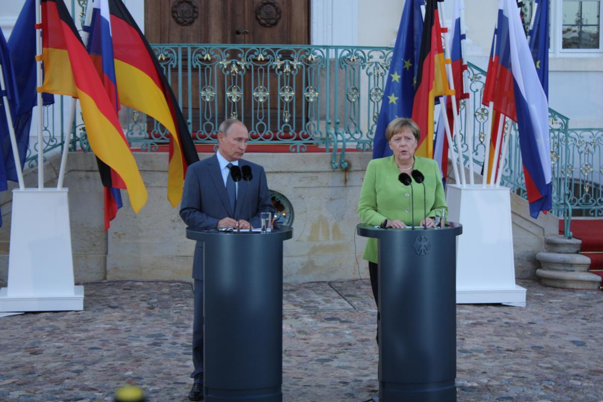 Russian President Vladimir Putin and German Chancellor Angela Merkel ahead of their work meeting at the German government's guest house in Meseberg. Source - Julian Wettengel CLEW.