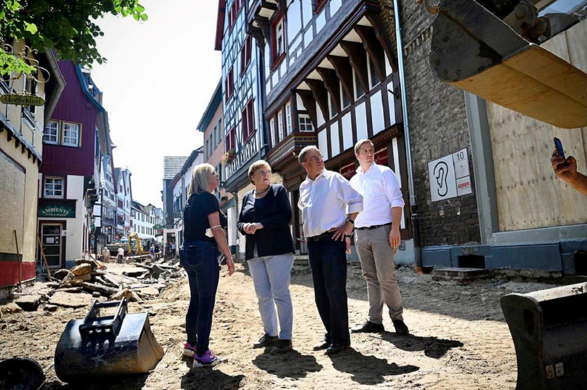 Angela Merkel visiting flood-hit Bad Münstereifel in North Rhine-Westphalia with state premier Armin Laschet. Photo: Bundesregierung/Steins.