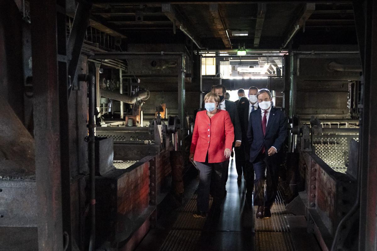 Chancellor Angela Merkel visits the former coal mine Zeche Zollverein in North Rhine-Westphalia. Photo: Bundesregierung / Kugler