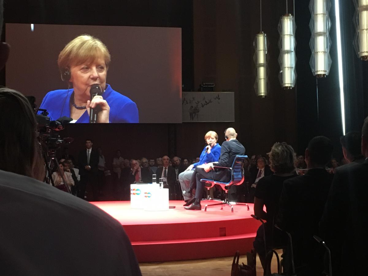 Merkel being interviewed at the Gloabl Solutions Summit in Berlin. Photo:CLEW