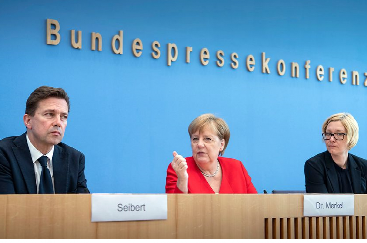 German Chancellor Merkel (center) at her annual press conference in Berlin. Photo - Bundesregierung/Bergmann