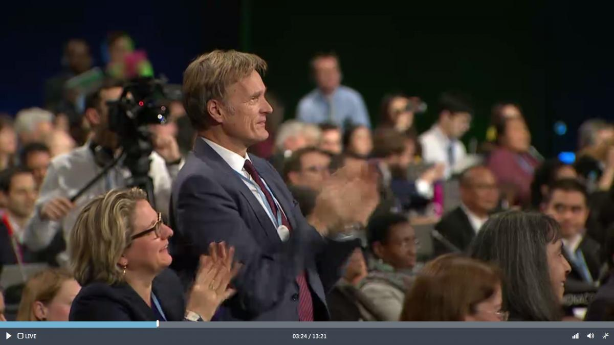 Germany's environment minister Svenja Schulze and head negotiator Karsten Sach applauding the outcome and presidency of COP24.