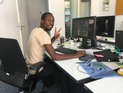 Mwelwa Musonko (@MwelxTax) is visiting cartoonist at the Clean Energy Wire CLEW in July 2018. Photo - CLEW.