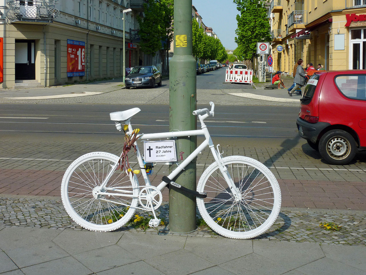 "Photo of a white ""ghost bike"", which marks spots where cyclists have been killed in Berlin. Photo: Lotse."