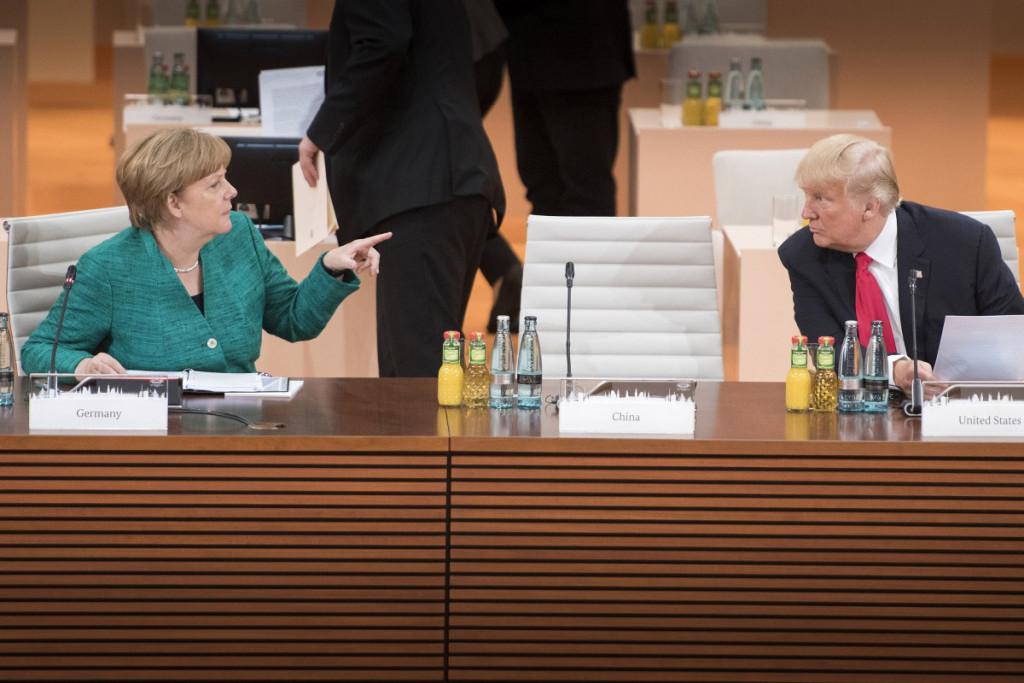 Merkel in conversation with Trump in Hamburg at the G20 summit 2017. Photo: German Government/Bergmann