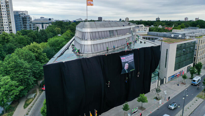 "Activistst covered the CDU party headquarters to protest against the government's ""shady deals"" with the coal industry. Photo: Greenpeace"