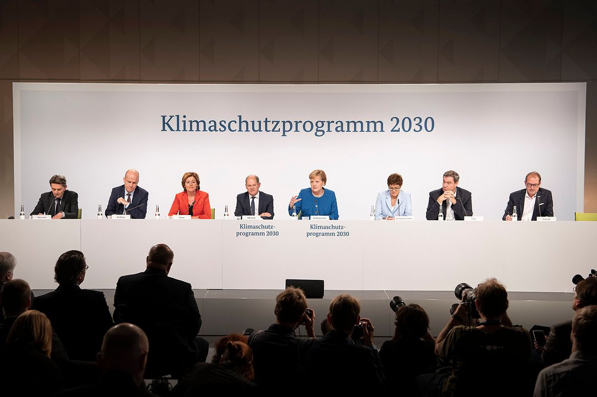 Merkel and other leading policymakers present Germany's Climate Action Programme 2030 at the end of last year. Photo: Bundesregierung/Bergmann